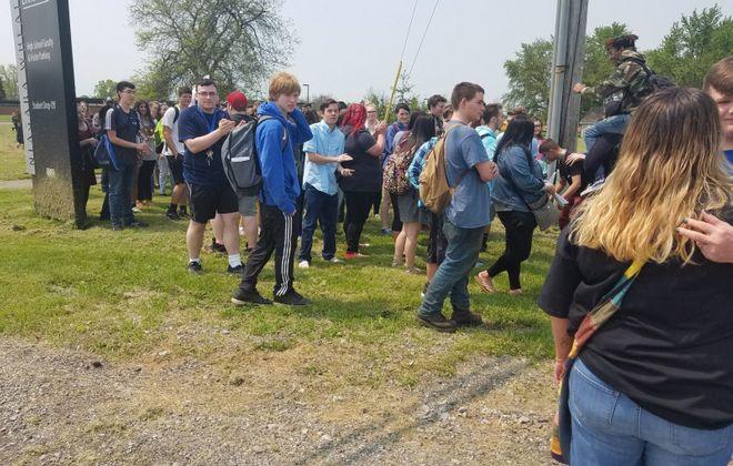 "Around 100 students took part in a walkout at Niagara Wheatfield High School Friday despite an announcement by Principal Michael Mann of ""consequences."" (Thomas J. Prohaska/Buffalo News)"