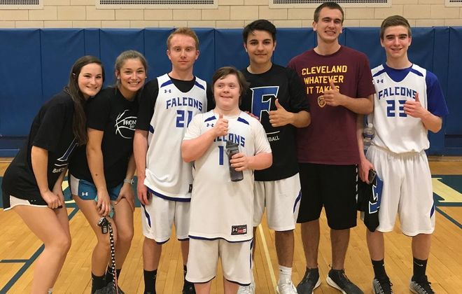 Reed Heinrich, center, with water bottle, with some teammates on Frontier unified basketball team, l to r: Emily Applegate, Macy Kuebler, Danny Oar, Jonah Kozak, Matt Clifford and Nate Dolan. (Submitted image)