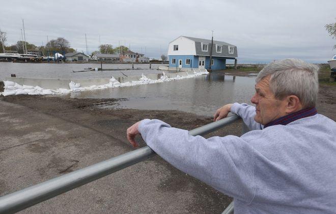 Newfane Supervisor Timothy R. Horanburg surveyed Lake Ontario flooding at Olcott in May 2019. (John Hickey/News file photo)