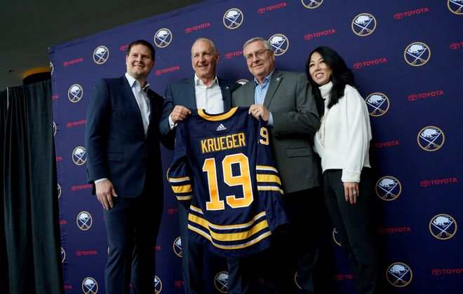 Buffalo Sabres GM Jason Boterill, left, and team owners Terry and Kim Pegula, right, introduce new coach Ralph Krueger to the media Wednesday at KeyBank Center. (Derek Gee/Buffalo News)
