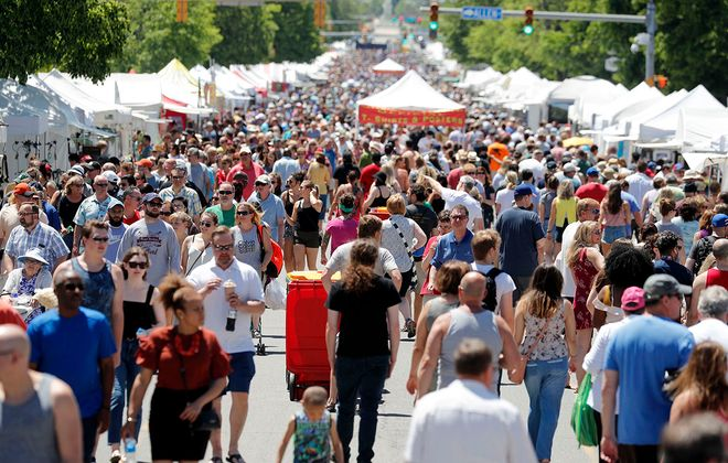 People walk up Delaware Ave during the 62nd annual Allentown Art Festival in Buffalo on Saturday, June 8, 2019. (Mark Mulville/News file photo)