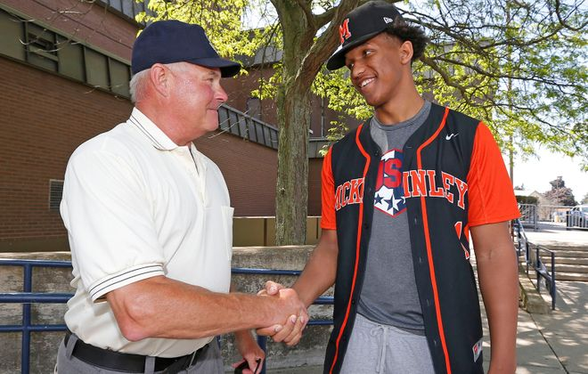 """Alexander """"Gator"""" Johnson, right, and Doug Zavodny, a longtime umpire, speak at Demske Field about how they were both selected in the baseball draft out of McKinley High School.  (Robert Kirkham/Buffalo News)"""