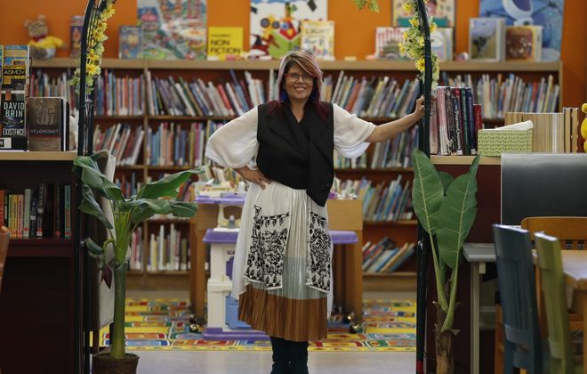 Donna White, at Brighton Place Library in the Town of Tonawanda, wears a favorite outfit for Fashion Friday. (Sharon Cantillon/Buffalo News)