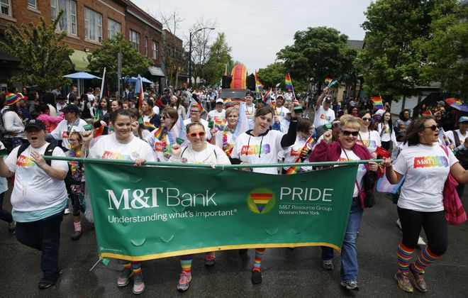 M&T Bank, a sponsor of Buffalo's Pride Parade for the seventh straight year, was one of more than 25 companies marching down Elmwood Avenue on Sunday. (Sharon Cantillon/Buffalo News)