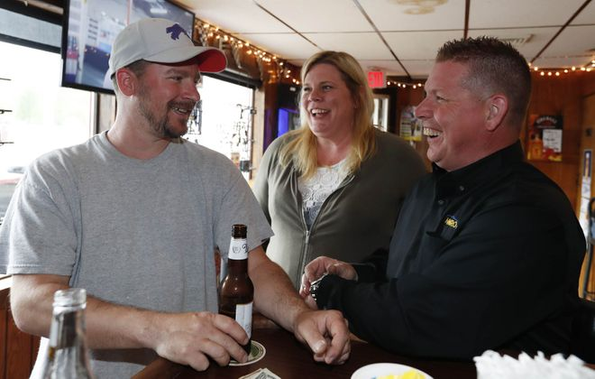 Hanging out in Gene's Junkyard, from left, are Andy Montague of the Town of Tonawanda, and Lisa and Randy York of Grand Island. (Sharon Cantillon/Buffalo News)