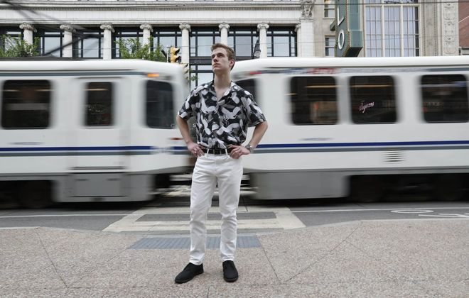 Ryan Dils shows off his style on Main Street in downtown Buffalo. (Sharon Cantillon/Buffalo News)