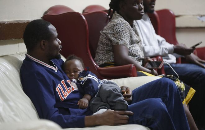 Nearly 100 Congolese asylum-seekers just released from the southern border arrived at Vive Shelter on the city's East Side last week. Some of them wait in the lobby of the shelter on Monday, June 17, 2019. (Mark Mulville/Buffalo News)