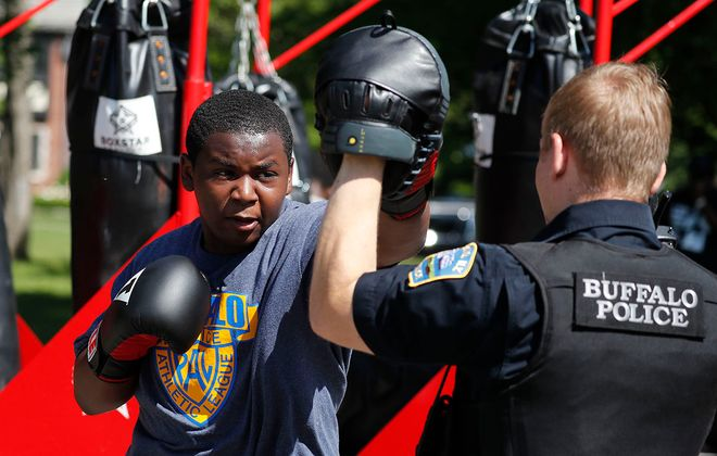 Buffalo Community Police Officer Ryan Urbanski does a boxing workout during a Police Athletic League event in Delaware Park in Buffalo on Sunday, June 23, 2019. (Mark Mulville/Buffalo News)