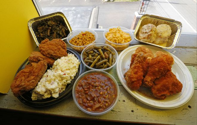 At Rt. 16 Chicken Shack in Elma, picnic-style family servings of sides like collard greens,beans and mac and cheese, can be ordered with your fried chicken. (Robert Kirkham/Buffalo News)