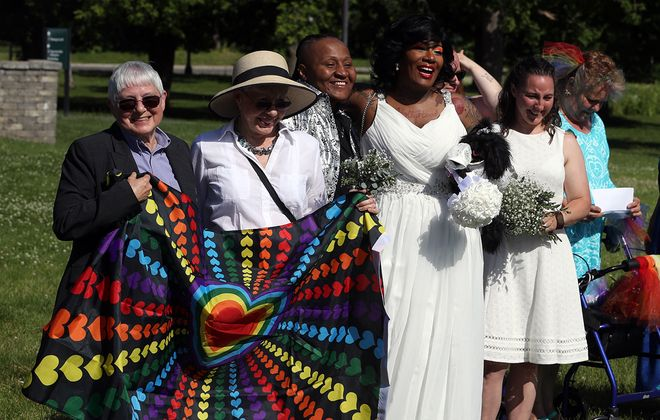 Bonnie Strunk, left,  and her longtime partner, Karen Salsgiver, both of suburban Syracuse, got married in a wedding and vow-renewal ceremony for LGBTQ couples Sunday on Goat Island in Niagara Falls State Park. (John Hickey/Buffalo News)