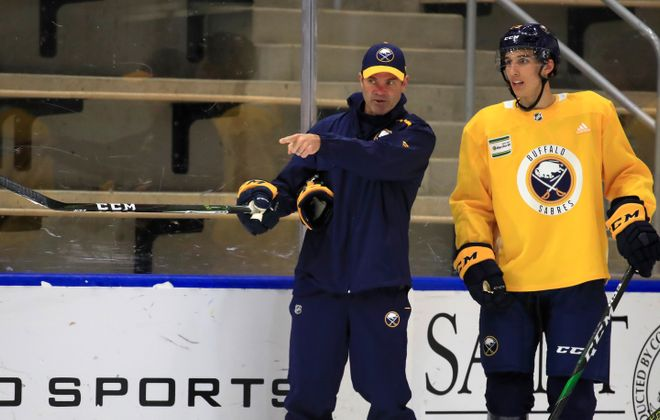 Buffalo Sabres prospect Dylan Cozens gets instructions from Rochester Americans coach Chris Taylor during development camp on Wednesday, June 26, 2019. (Harry Scull Jr./Buffalo News)