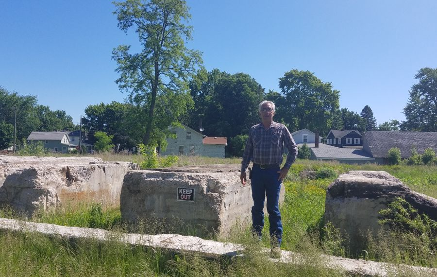 Scott Krzyzanowski stands on the foundation of a former power plant at the cleaned-up Superfund site he owns at 89 Mill St., Lockport, on June 7, 2019. (Thomas J. Prohaska/The Buffalo News)