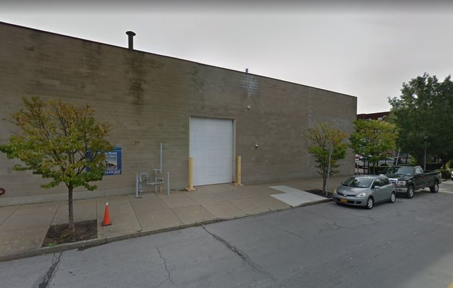 Uniland Development Co. plans to renovate this empty warehouse at 505 Ellicott St. and add another floor to create a new high-end coworking space. (Google)