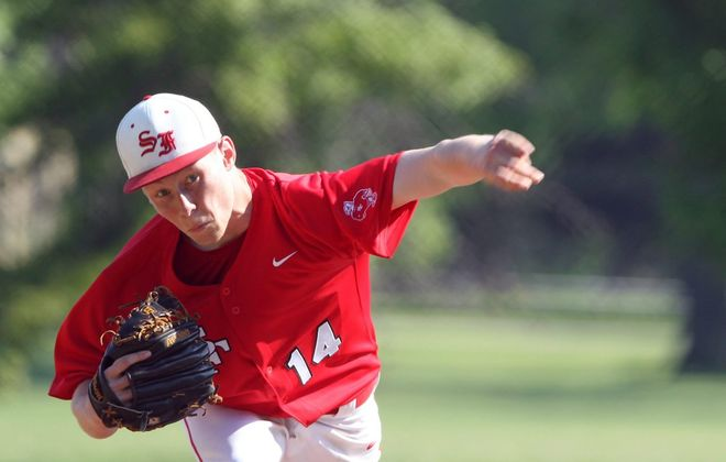 Matt Minnick throws a fast ball for St. Francis in 2014.  (James P. McCoy/News file photo)