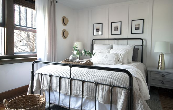 "Interior designer Caroline Barr created this serene master bedroom for a client in South Buffalo. The framed prints above the bed are from three of the homeowner's favorite places. ""It's something I love to do for my clients because it brings a sense of happiness and self to their bedroom,"" she says.  (Courtesy Caroline Barr)"