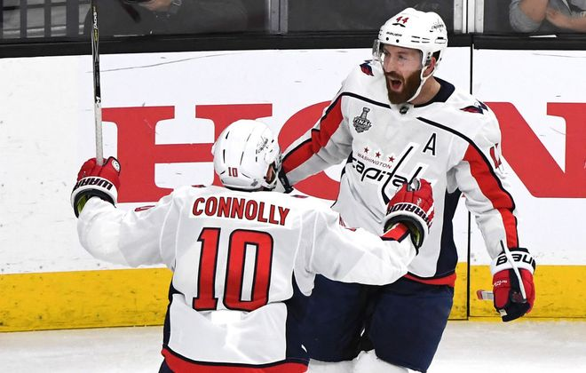 Brooks Orpik, right, celebrates with Brett Connolly after scoring what proved to be the winning goal of Game 2 in the Stanley Cup final at Vegas on May 30, 2018 (Getty Images).