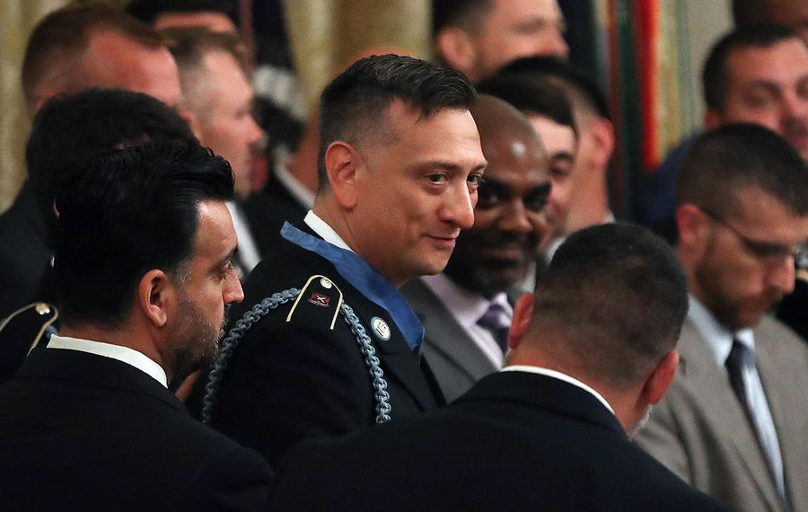 David Bellavia stands with the men he served with in Iraq after President Trump gave him the Medal of Honor on June 25. (Getty Images)