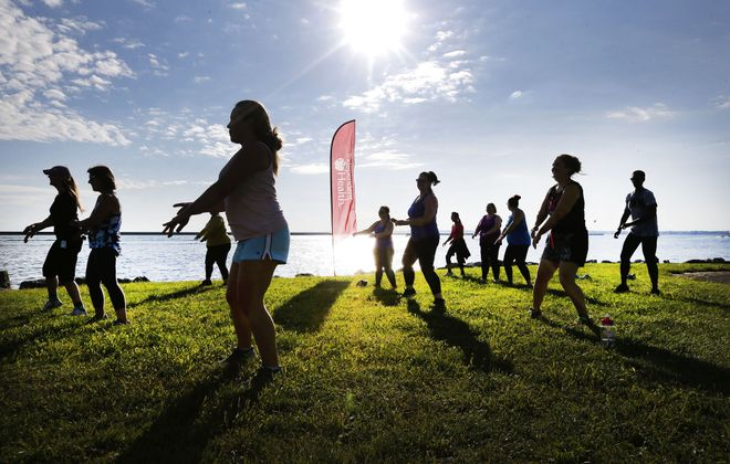 A Tuesday evening Independent Health-sponsored Fitness in the Parks Zumba class is among several group fitness classes held each week at Wilkeson Pointe on the Outer Harbor. (Robert Kirkham/Buffalo News)