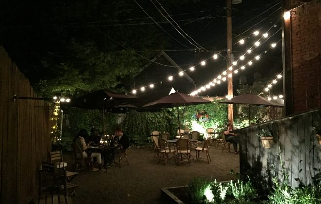 Coco is a romantic place. It's French. But the patio, with its twinkle lights and flowers, is even more romantic than the interior. (Francesca Bond/Buffalo News)