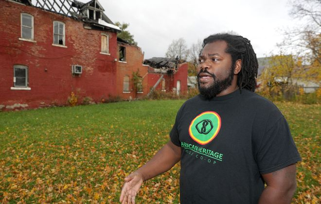 Alexander Wright's African Heritage Food Co-Op finally owns this fire-damaged Fruit Belt landmark. (John Hickey/News file photo)