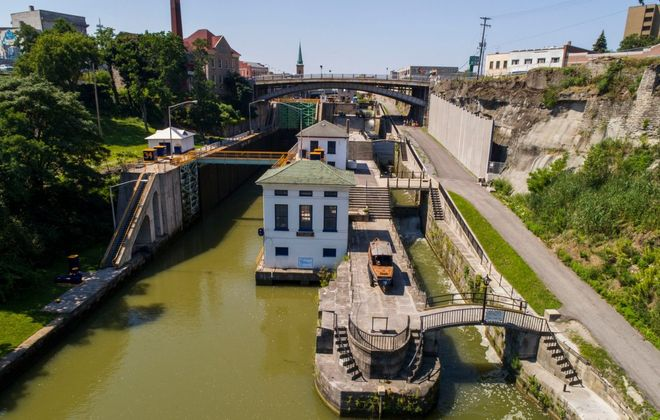 In this view of the Erie Canal locks at Lockport, the two modern locks are on the left and the 19th-century Flight of Five is on the right. (Derek Gee/News file photo)