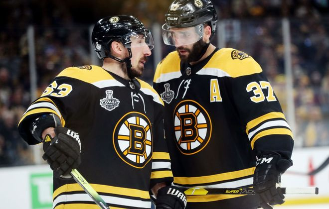 Brad Marchand, left, and  Patrice Bergeron both played on Boston's 2011 Stanley Cup championship team. (Getty Images)