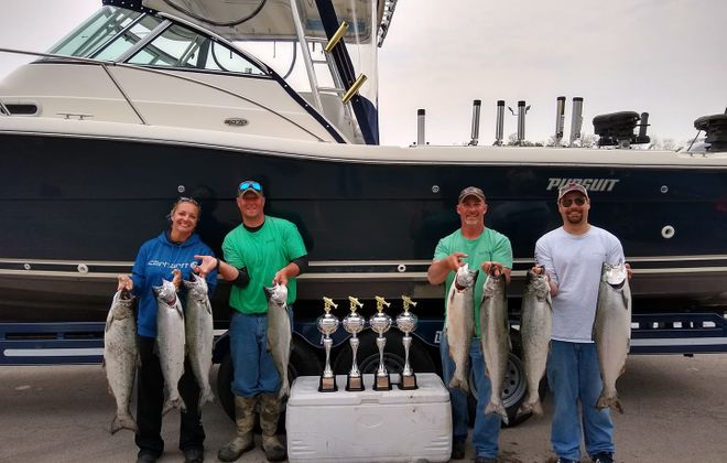 This year's winning team in the Professional Division of the Niagara Pro-Am Salmon Team Tournament was Oh Baby/Irish Knots. Pictured are (from right to left) team leader Matt LeClair of Plattsburgh, Capt. Chris Yard of Pomeroy, Matt and Sarah Hill of Sherbourne. Lake Ontario is producing some excellent salmon fishing. The tournament was May 31 and June 1. (Photo by Matt LeClair)