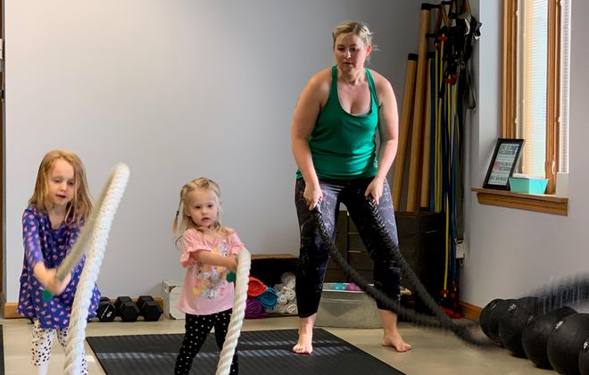 Aurora Higgins, 2, and Lyra Rapsinski, 2, take a turn on the ropes at Vitality Buffalo under the watchful eye of Lyra's mom, Ashley. The fitness center in Blasdell caters to moms and their kids, while making room for other busy adults in its group fitness classes, too. (Scott Scanlon/Buffalo News)