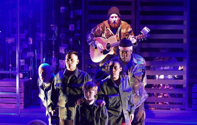 """Zak Ward (center rear) with cast-members of MusicalFare's """"Late in the Evening: The World According to Paul Simon."""" (Photo courtesy Michael Walline)"""