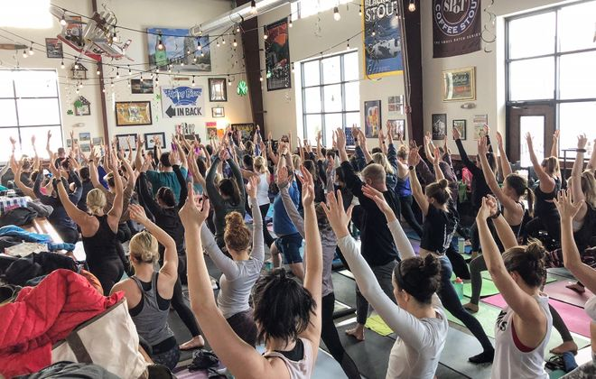 Flying Bison Brewing Co. will launch a new monthly yoga class on June 17 to benefit regional nonprofits. (Photo courtesy of Flying Bison Brewing)