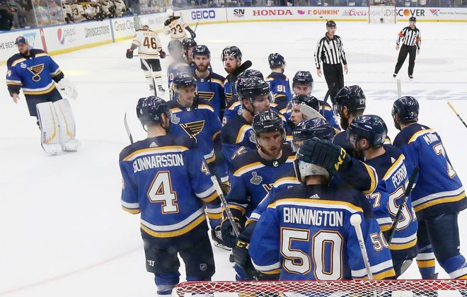 One more mob scene around goalie Jordan Binnington will mean a Stanley Cup for the St. Louis Blues. (Getty Images)