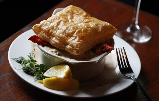 Lobster claws signal what lies beneath in Shamus' seafood pot pie, made with shrimp, blue crab, lobster and a puff pastry topper. (Sharon Cantillon/Buffalo News)