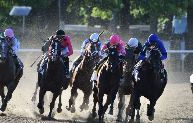 Sir Winston (second from right) peeks through Joevia (No. 1) and Tax (No. 4) before veering around them to win Belmont 151. (Photo courtesy of Hugh Ducey/NYRA)