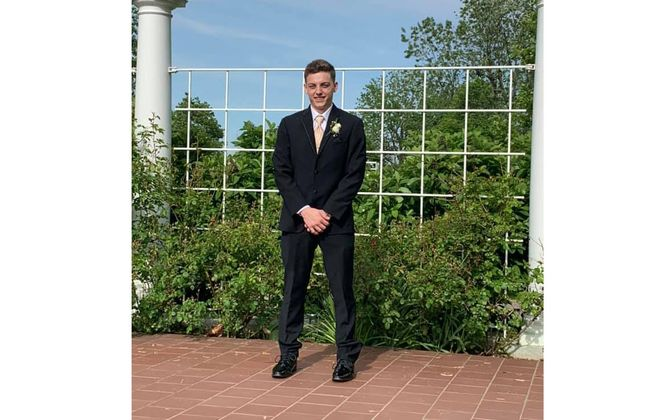 Edward J. Travis IV, 18, died Saturday morning in a crash on Southwestern Boulevard in West Seneca. This photo shows him the night before the crash at his senior prom. (Photo courtesy of Becca Travis)