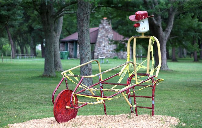 The cowboy with a wheelbarrow structure at Ellicott Creek Park in the Town of Tonawanda will be restored. (John Hickey/Buffalo News)