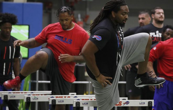 Buffalo Bills LaAdrian Waddle, right, and Dion Dawkins, left, go through voluntary workouts in the ADPRO Sports Training House in Orchard Park Monday, April 15, 2019.    (Mark Mulville/Buffalo News)