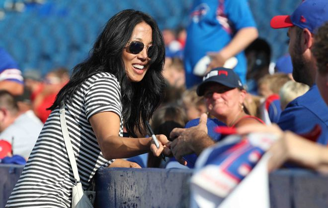 Buffalo Bills co-owner Kim Pegula signs autographs during practice at New Era Field on Friday, Aug. 2, 2019. (James P. McCoy/Buffalo News)