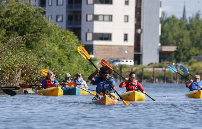 Marcus Rosten, community engagement coordinator for Buffalo Niagara Waterkeeper, center, leads a Buffalo River kayak tour hosted by the Western New York Land Conservancy in partnership with  Buffalo Niagara Waterkeeper on Saturday, Aug. 10, 2019. (Derek Gee/Buffalo News)