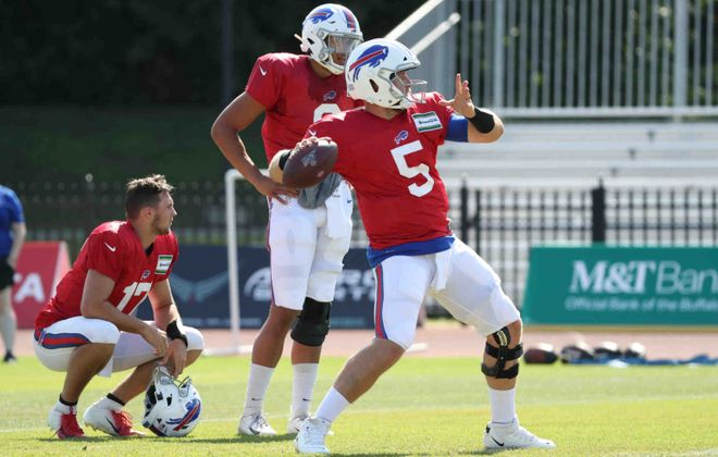 Buffalo Bills quarterback Matt Barkley works on his footwork during passing drills last summer with Josh Allen and Tyree Jackson looking on ( James P. McCoy/Buffalo News file photo)