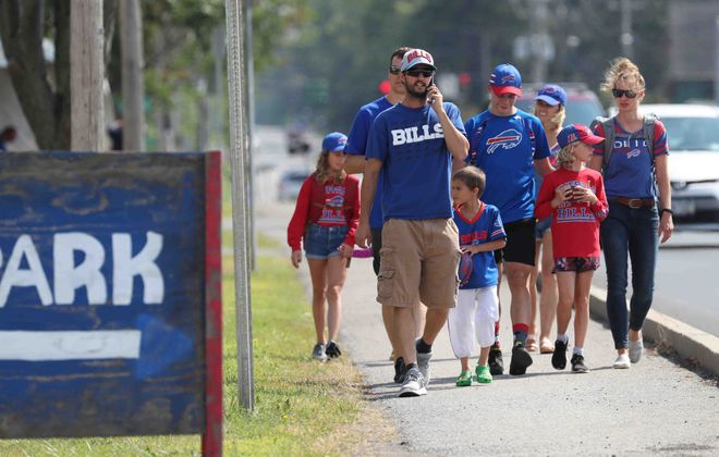 Buffalo Bills fans enter the parking lot to tailgating at New Era Field (ames P. McCoy/Buffalo News file photo)