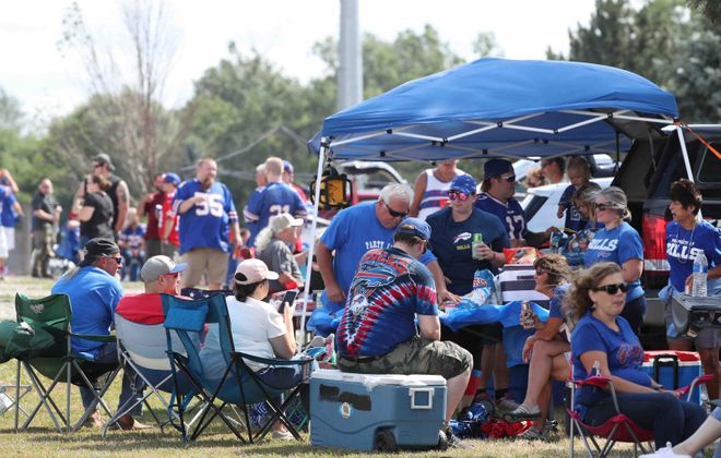Buffalo Bills fans tailgate during pregame at New Era Field in Orchard Park. The scene could be very different in the coming season. (James P. McCoy/News file photo)