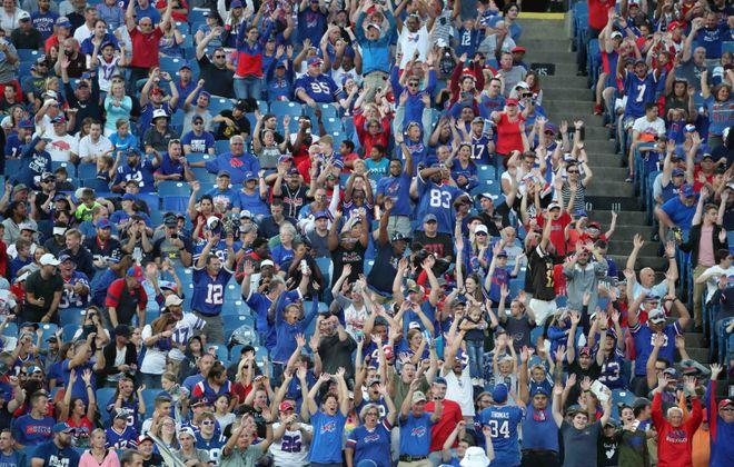 Buffalo Bills fans do the wave at New Era Field. (James P. McCoy/News file photo)