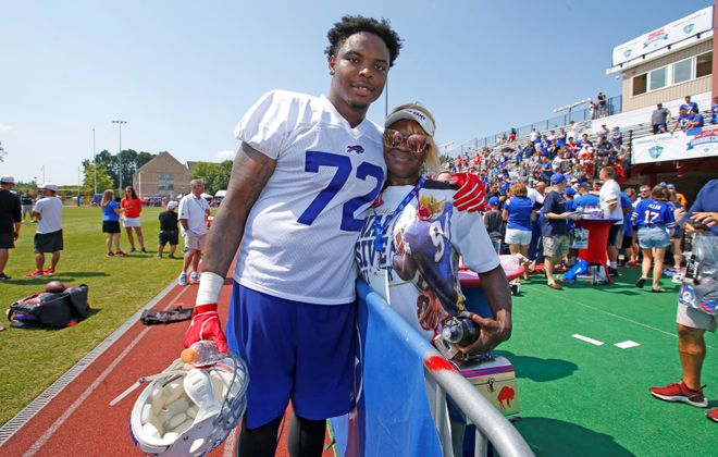 New Bills offensive tackle Jarron Jones, a Rochester native, greeted his mother, Lakiescha with a hug after his first practice. (Harry Scull Jr./Buffalo News)