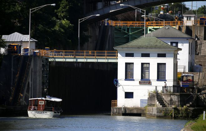 The Lockview IV, operated by Lockport Locks and Erie Canal Cruises, sails into the locks on the Erie Canal in Lockport Aug. 11, 2019. (Mark Mulville/News file photo)