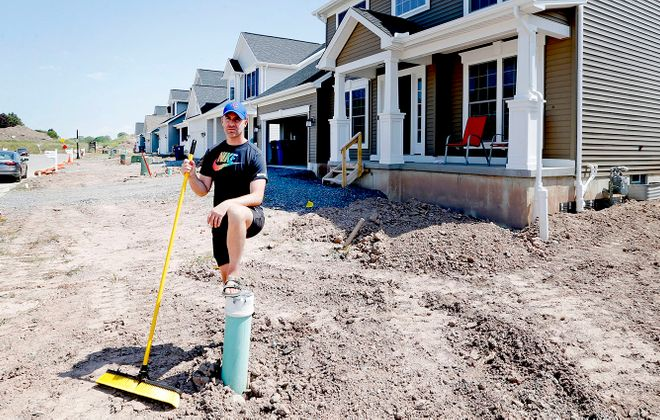 Homeowner Brett Barrett and others are getting frustrated with the completion schedule of their Colvin Estates homes. (Robert Kirkham/Buffalo News)