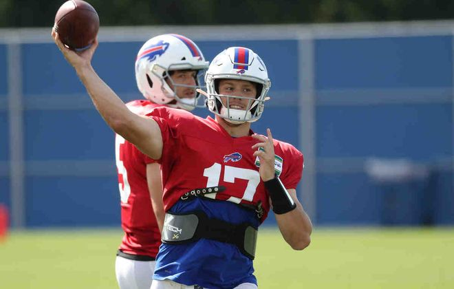 Buffalo Bills quarterback Josh Allen throws a pass in a drill during practice (James P. McCoy/Buffalo News)