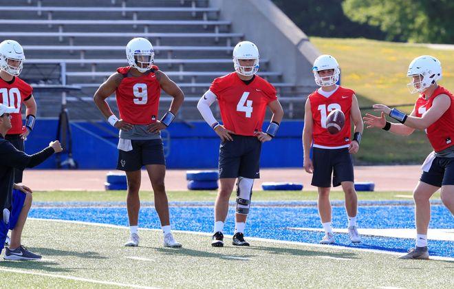 University at Buffalo quarterback Kyle Vantrease (7) waits for a snap as Matt Myers (10), Dominic Johnson (9), Trevor Bycznski (4) and Aaron Chase (12) watch.(Harry Scull Jr./Buffalo News)
