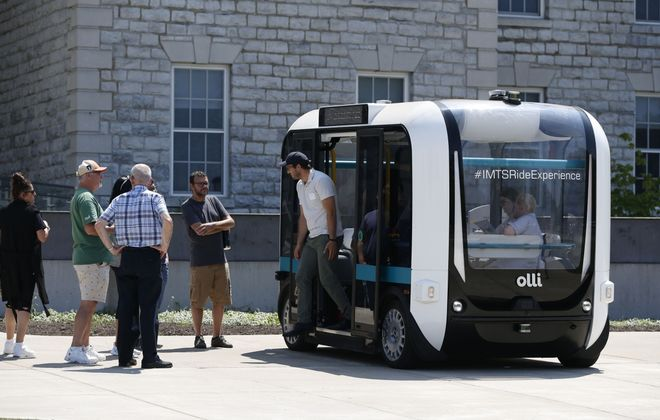 UB has been testing this driverless shuttle bus known as Olli for the past year. Forum participants got to check out the bus during their break. (Sharon Cantillon/News file photo)