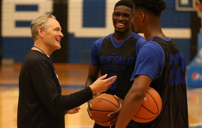 UB's new basketball recruits Josh Mballa, center, and LaQuill Hardnett talk with coach Jim Whitesell at Alumni Arena (John Hickey/Buffalo News)