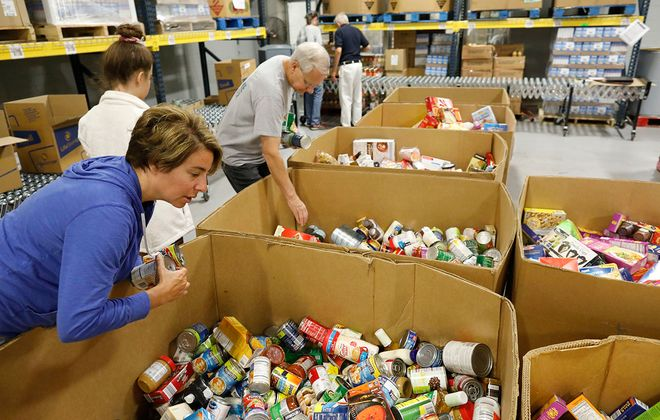 Volunteers at Feedmore WNY sort boxes of food in this file photo. To prevent Americans from going hungry during the coronavirus pandemic, Washington must expand the SNAP program. (Derek Gee/News file photo)